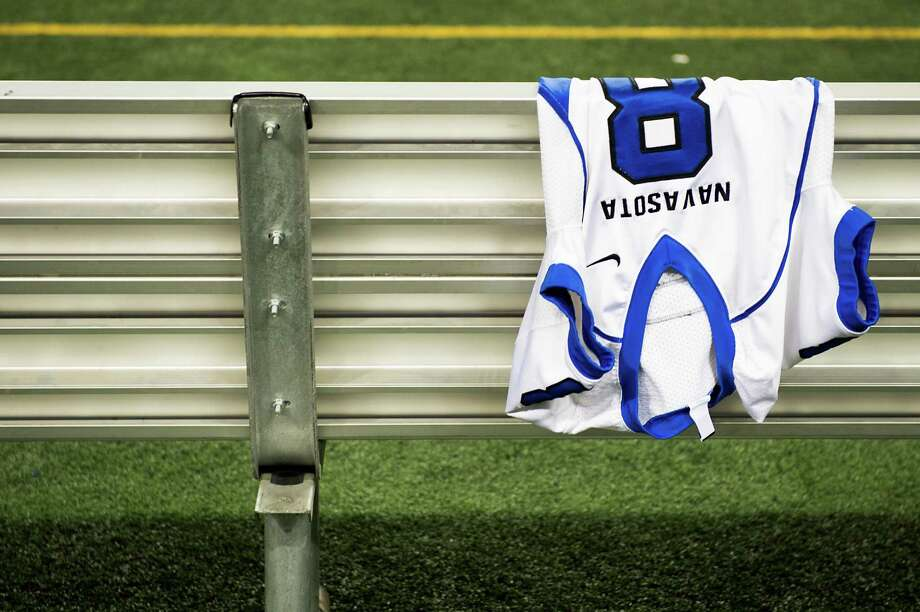 The jersey Navasota's Xavier Creeks (8) hangs over the bench in the final minute of the Ratttlers' 39-3 victory over Gilmer. Photo: Smiley N. Pool, Houston Chronicle / © 2012  Houston Chronicle