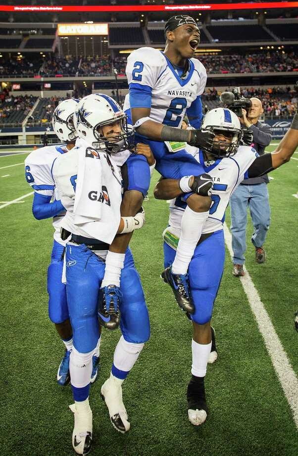 Navasota's Austin Collins (2) is carried by teammates in celebration after the Ratttlers' 39-3 victory over Gilmer. Photo: Smiley N. Pool, Houston Chronicle / © 2012  Houston Chronicle
