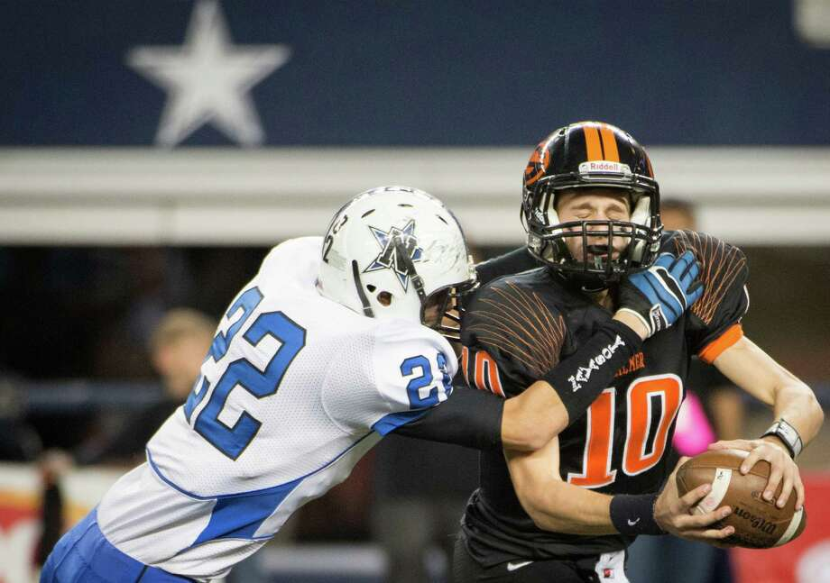 Navasota's Anthony Small (22) sacks Gilmer quarterback  Tanner Barr (10) during the second half. Photo: Smiley N. Pool, Houston Chronicle / © 2012  Houston Chronicle