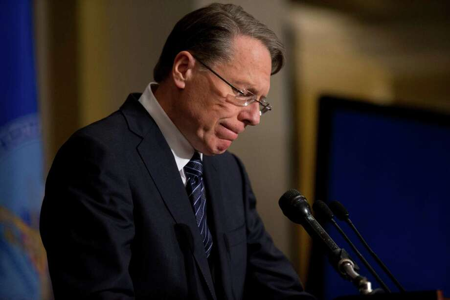 National Rifle Association executive vice president Wayne LaPierre pauses as he makes a statement during a news conference in response to the Connecticut school shooting, on Friday, Dec. 21, 2012 in Washington. The National Rifle Association broke its silence Friday on last week's shooting rampage at a Connecticut elementary school that left 26 children and staff dead. (AP Photo/ Evan Vucci) Photo: AP, STF / The Associated Press2012