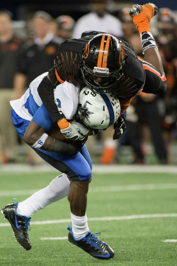 Gilmer linebacker Ardarious Johnson leaps over over Navasota's Austin Collins (2) as he makes a tackle during the second half. Photo: Smiley N. Pool, Houston Chronicle / © 2012  Houston Chronicle
