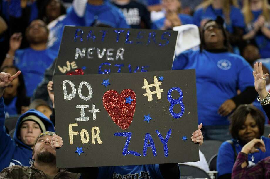 Navasota fans hold up signs showing support for running back Xavier Creeks during the second half against Gilmer. Photo: Smiley N. Pool, Houston Chronicle / © 2012  Houston Chronicle
