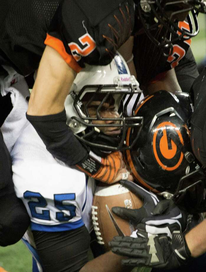 Navasota's Howard Horn (25) is brought down by the Gilmer defense during the second half of the Class 3A Division II state championship football game. Photo: Smiley N. Pool, Houston Chronicle / © 2012  Houston Chronicle