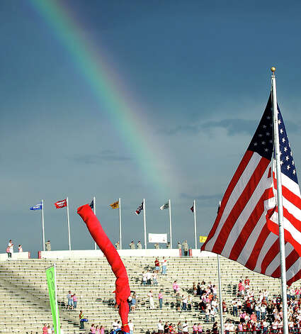 A rainbow shows its colors as fans stand for the National Anthem before the start of the Arkansas Pine-Bluff-New Mexico State football game at Aggie Memorial Stadium on Sept. 29, 2007.  New Mexico State University is offering football fans $2 tickets for Saturday's home game against Louisiana Tech in an effort to help meet NCAA attendance requirements. NMSU could face NCAA sanctions if the school does not hit a benchmark of 15,000 fans per home game in the 2008 football season. (AP photo/Las Cruces Sun-News, Norm Dettlaff) Photo: Norm Dettlaff, Express-News / AP2007