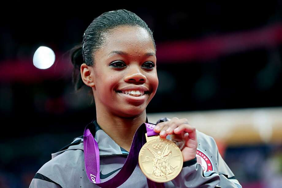 FILE - DECEMBER 8, 2012:  Nominations are being voted on and the winners in the 'TIME Person of the Year' 2012 will be announced on December 14th. LONDON, ENGLAND - AUGUST 02:  Gabrielle Douglas of the United States celebrates on the podium after winning the gold medal in the Artistic Gymnastics Women's Individual All-Around final on Day 6 of the London 2012 Olympic Games at North Greenwich Arena on August 2, 2012 in London, England.  (Photo by Ronald Martinez/Getty Images) Photo: Ronald Martinez, Getty Images