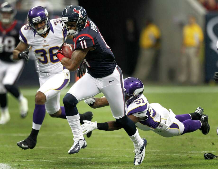 The Texans' DeVier Posey, center, scored an 80-yard touchdown in a preseason game against the Vikings. Photo: Brett Coomer, Staff / © 2012  Houston Chronicle