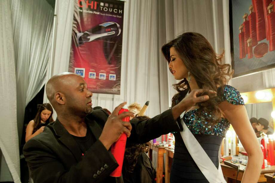 Miss Peru, Nicole Faveron, gets her hair done. Photo: Valerie Macom, Miss Universe Organization / Miss Universe Organization
