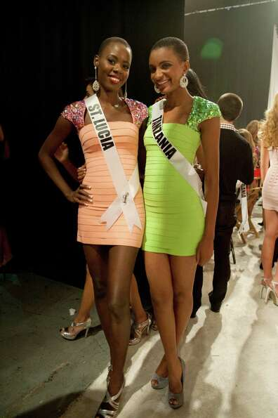 Miss St. Lucia, Tara Edward, and Miss Tanzania, Winfrida Dominic, pose backstage.