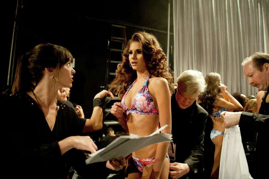 Miss France, Marie Payet, prepares backstage. Photo: Valerie Macom, Miss Universe Organization / Miss Universe Organization