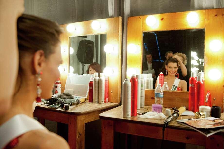 Miss Dominican Republic, Dulcita Lieggi, gets her hair done. Photo: Valerie Macom, Miss Universe Organization / Miss Universe Organization