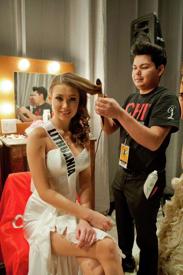 Miss Lithuania, Greta Mikalauskyte, gets her hair done. Photo: Darren Decker, Miss Universe Organization / Miss Universe Organization