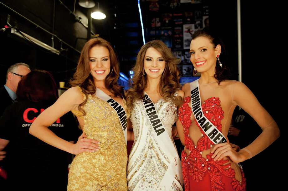 Miss Panama, Stephanie Vander Werf, Miss Guatemala, Laura Godoy, and Miss Dominican Republic, Dulcita Lieggi, backstage. Photo: Valerie Macom, Miss Universe Organization / Miss Universe Organization