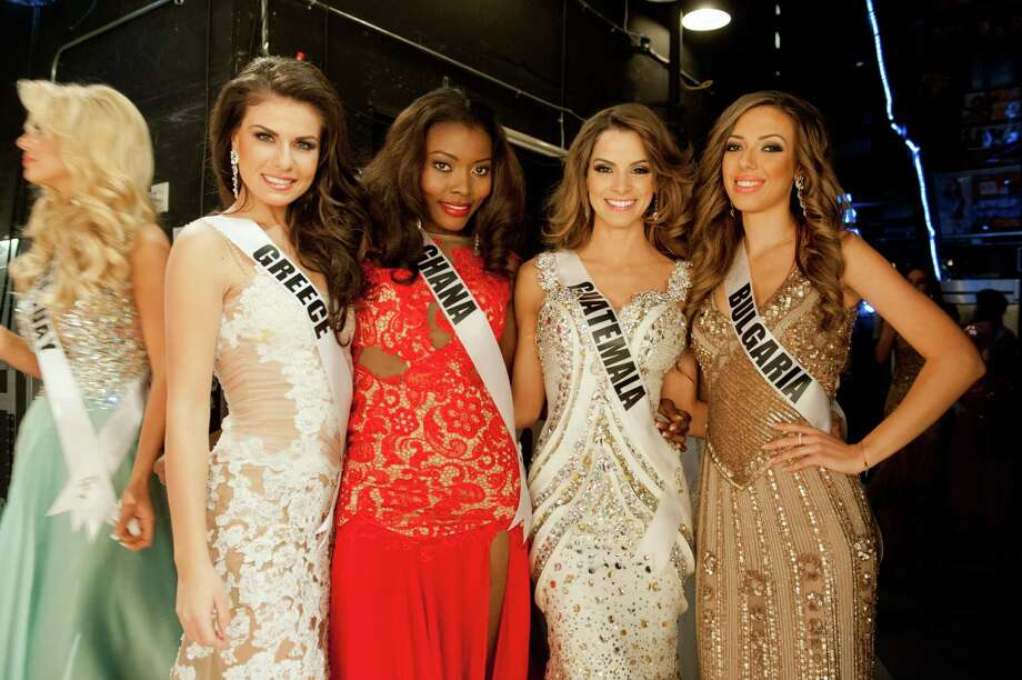 Miss Greece, Vasiliki Tsirogianni, Miss Ghana, Gifty Ofori, Miss Guatemala, Laura Godoy, and Miss Bulgaria, Zhana Yaneva, pose backstage. Photo: Valerie Macom, Miss Universe Organization / Miss Universe Organization