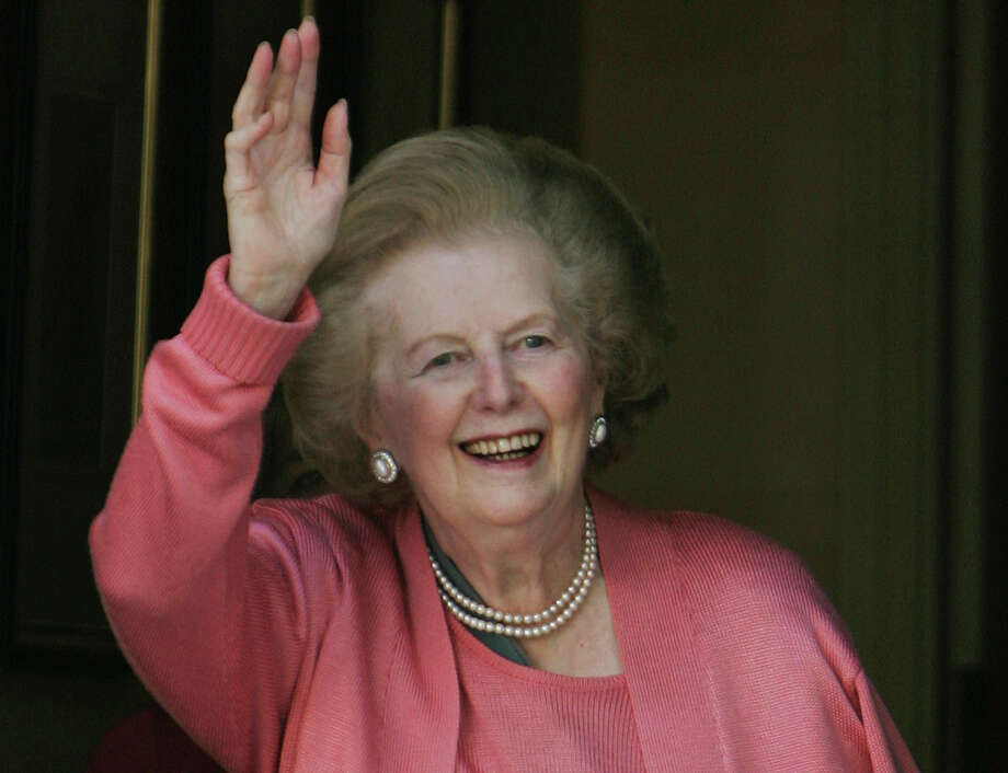 "FILE- Former British Prime Minister Margaret Thatcher, gestures to members of the media following her return home from hospital suffering from a broken arm, in central London, in this file photos dated Monday June 29, 2009.  87-year old Thatcher is recuperating at an unnamed hospital, Friday Dec. 21, 2012, after an operation to remove a bladder growth, which was ""completely satisfactory"", according to adviser Tim Bell, who did not give further details. (AP Photo/Lefteris Pitarakis, File) Photo: LEFTERIS PITARAKIS, STF / AP"