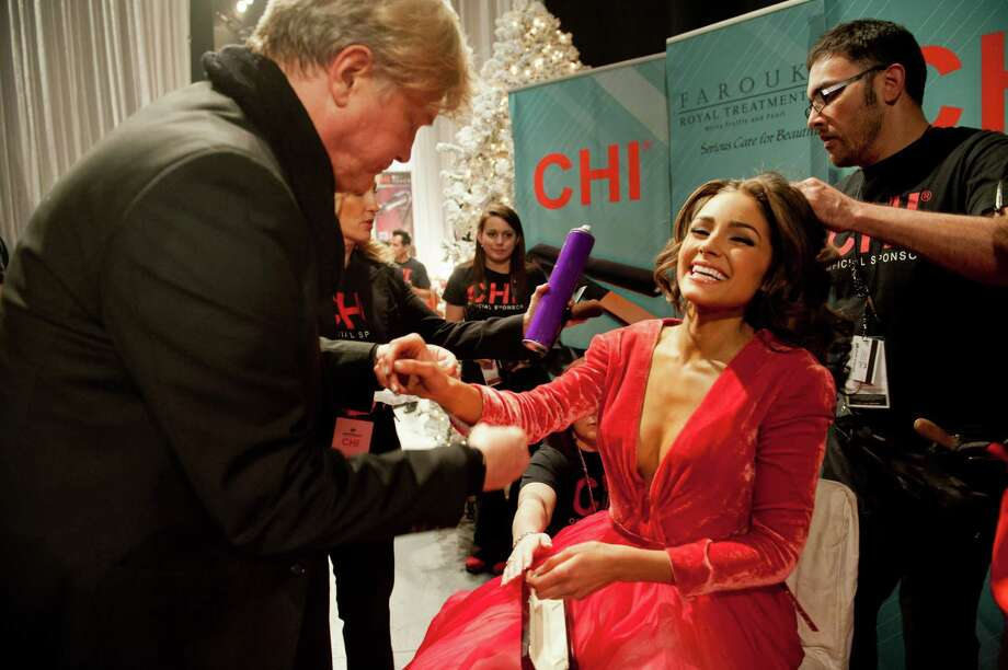 Miss USA, Olivia Culpo, gets her hair done. Photo: Valerie Macom, Miss Universe Organization / Miss Universe Organization