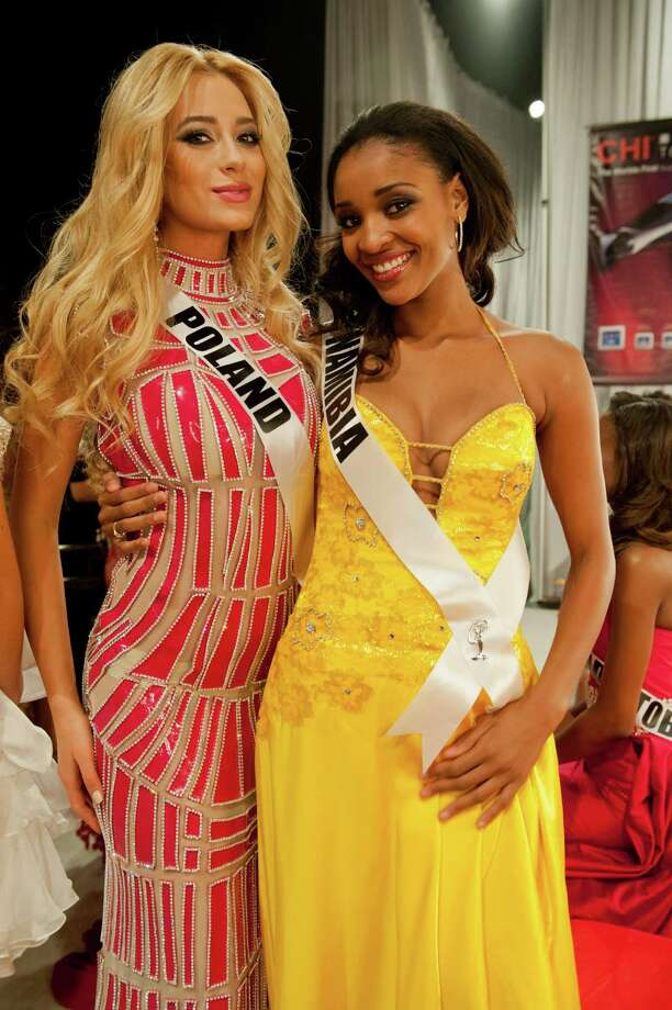 Miss Poland, Marcelina Zawadzka, and Miss Namibia, Tsakana Nkandih, pose backstage. Photo: Valerie Macom, Miss Universe Organization / Miss Universe Organization