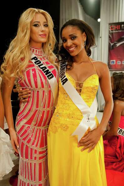 Miss Poland, Marcelina Zawadzka, and Miss Namibia, Tsakana Nkandih, pose backstage.