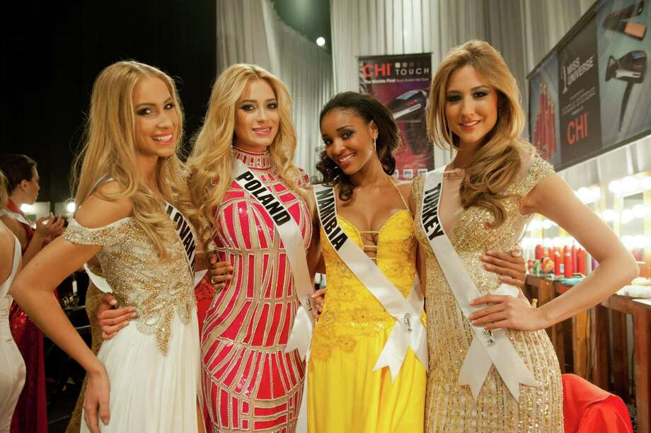 Miss Slovak Republic, Lubica Stepanova, Miss Poland, Marcelina Zawadzka, Miss Namibia, Tsakana Nkandih, and Miss Turkey, Cagil Ozge Özkul, pose backstage. Photo: Valerie Macom, Miss Universe Organization / Miss Universe Organization