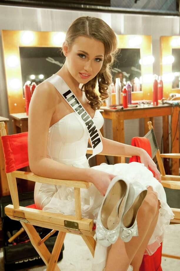 Miss Lithuania, Greta Mikalauskyte, poses backstage. Photo: Valerie Macom, Miss Universe Organization / Miss Universe Organization