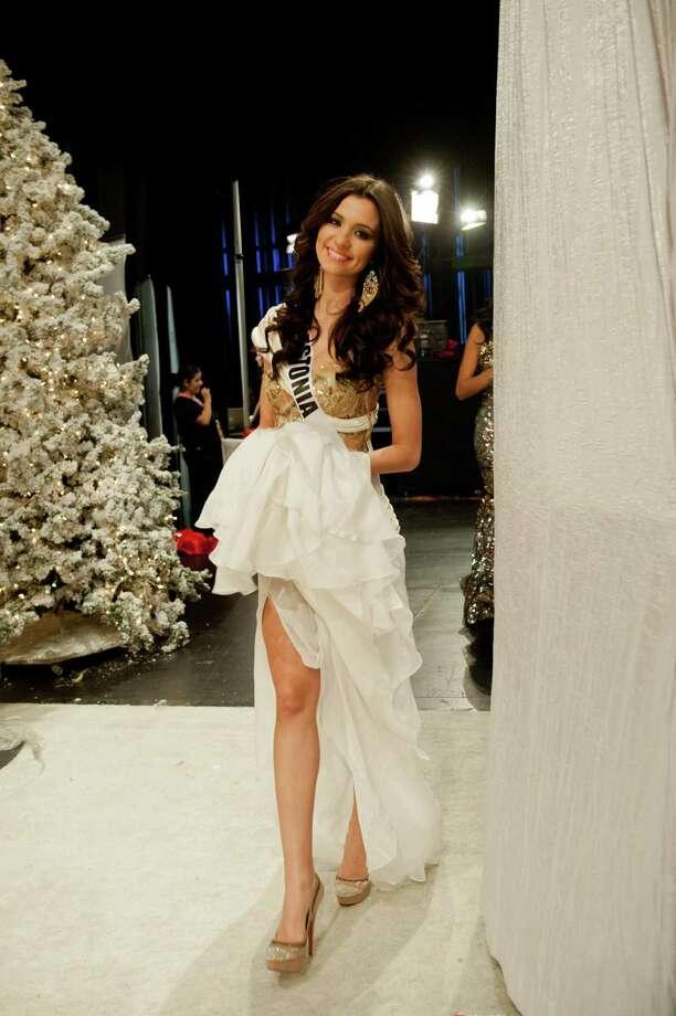 Miss Estonia, Natalie Korneitsik, smiles backstage. Photo: Valerie Macom, Miss Universe Organization / Miss Universe Organization