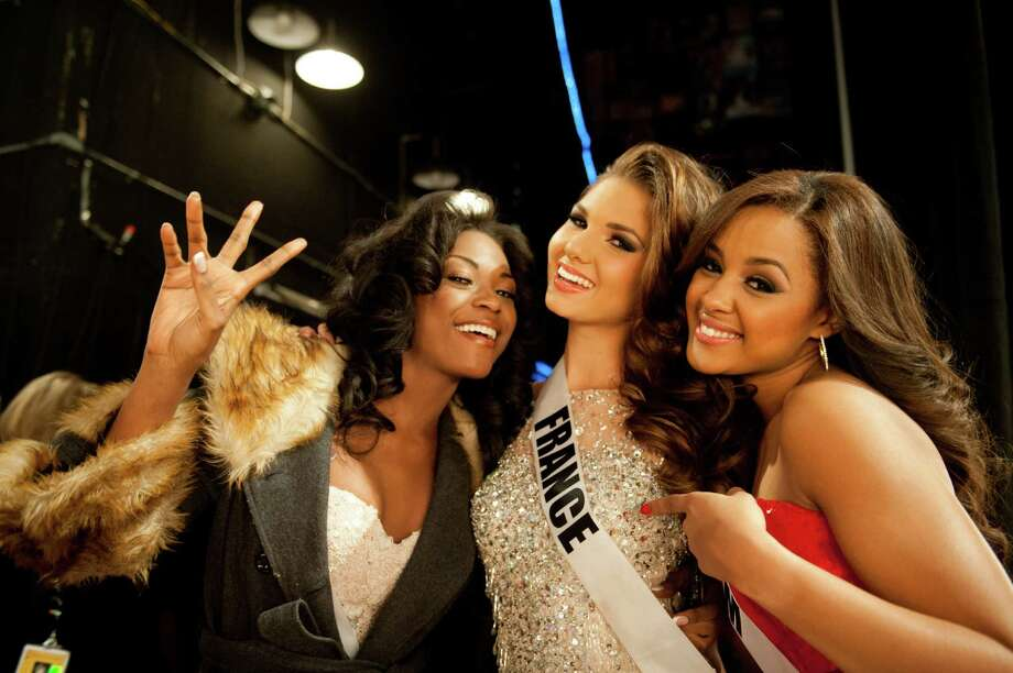 Miss Gabon, Channa Divouvi, Miss France, Marie Payet, and Miss Belgium, Laura Beyne, pose backstage. Photo: Valerie Macom, Miss Universe Organization / Miss Universe Organization