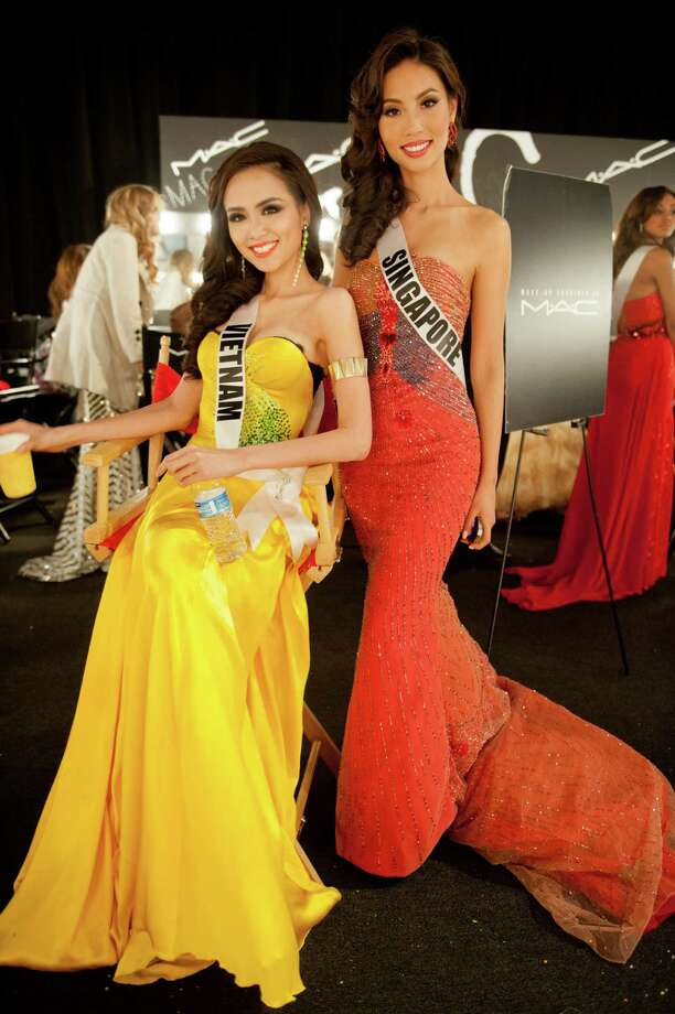 Miss Vietnam, Diem Huong Luu, and Miss Singapore, Lynn Tan, pose backstage. Photo: Valerie Macom, Miss Universe Organization / Miss Universe Organization
