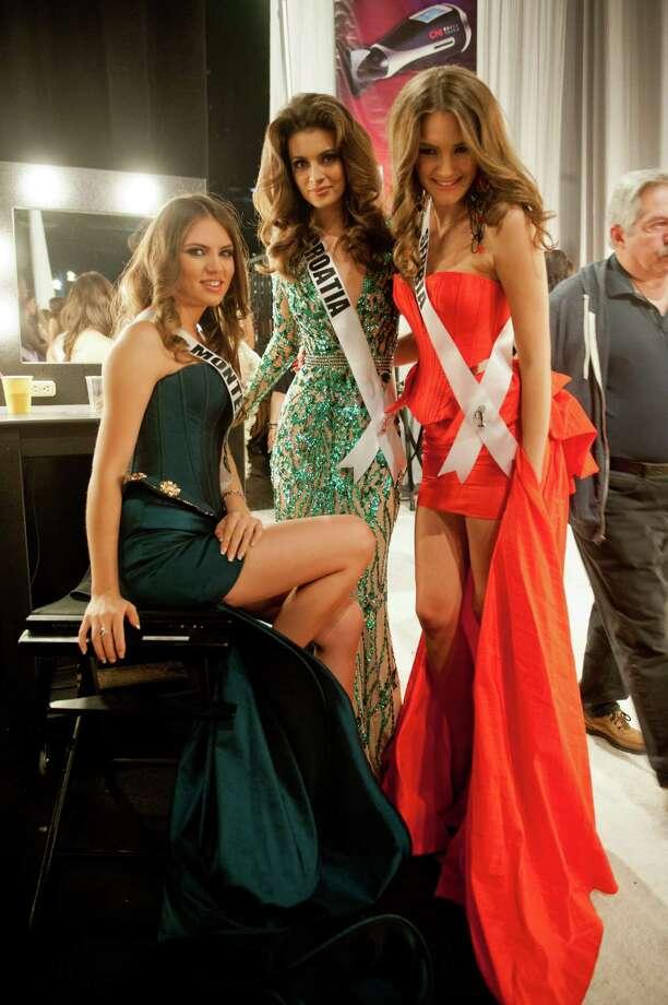 Miss Montenegro, Andrea Radonjić, Miss Croatia, Elizabeta Burg, and Miss Serbia, Branislava Mandić, pose backstage. Photo: Valerie Macom, Miss Universe Organization / Miss Universe Organization