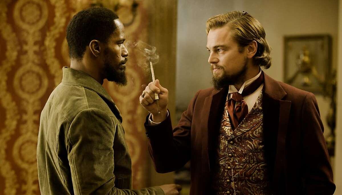 Jamie Foxx as Django and Leonardo DiCaprio as Calvin Candle in DJANGO UNCHAINED