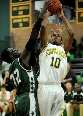 Trinity Catholic's Neno Merritt takes a shot during Friday's boys basketball game at Trinity Catholic High School in Stamford on December 21, 2012. Photo: Lindsay Niegelberg, Niegelberg / Stamford Advocate