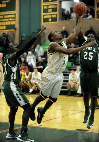 Trinity Catholic's Brandon Wheeler takes a shot during Friday's boys basketball game at Trinity Catholic High School in Stamford on December 21, 2012. Photo: Lindsay Niegelberg, Niegelberg / Stamford Advocate