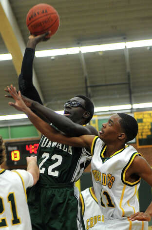 Norwalk's Roy Kane takes a shot during Friday's boys basketball game at Trinity Catholic High School in Stamford on December 21, 2012. Photo: Lindsay Niegelberg, Niegelberg / Stamford Advocate