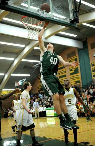 Norwalk's Luke Sweeney takes a shot during Friday's boys basketball game at Trinity Catholic High School in Stamford on December 21, 2012. Photo: Lindsay Niegelberg, Niegelberg / Stamford Advocate