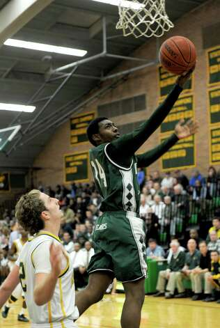 Norwalk's Jabari Dear takes a shot during Friday's boys basketball game at Trinity Catholic High School in Stamford on December 21, 2012. Photo: Lindsay Niegelberg, Niegelberg / Stamford Advocate