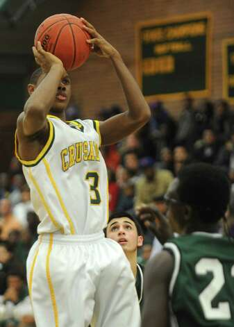 Trinity Catholic's Tremain Fraiser takes a shot during Friday's boys basketball game at Trinity Catholic High School in Stamford on December 21, 2012. Photo: Lindsay Niegelberg, Niegelberg / Stamford Advocate