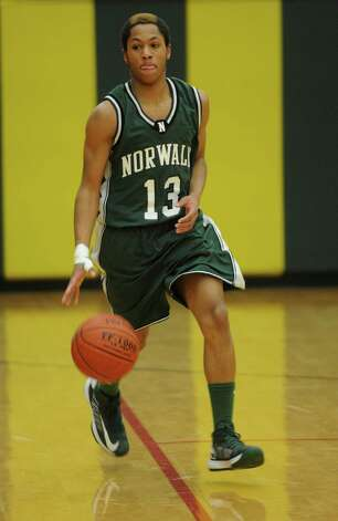 Norwalk's Jeremy Linton controls the ball during Friday's boys basketball game at Trinity Catholic High School in Stamford on December 21, 2012. Photo: Lindsay Niegelberg, Niegelberg / Stamford Advocate