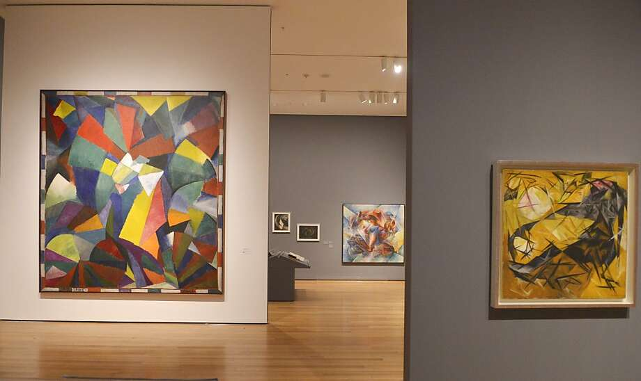 "Morgan Russell's ""Synchromy in Orange: To Form,"" left, is featured in the ""Inventing Abstraction: 1910-1925"" exhibit, which delves into the era's intoxication with this new language. Photo: Philip Greenberg, New York Times"