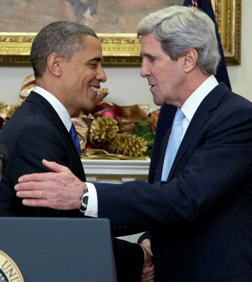 President Barack Obama, left, shakes hands with  Sen. John Kerry, D-Mass., as he announces his nomination of Kerry as next secretary of state in the Roosevelt Room of the White House, Friday, Dec. 21, 2012, in Washington. (AP Photo/Carolyn Kaster) Photo: Carolyn Kaster