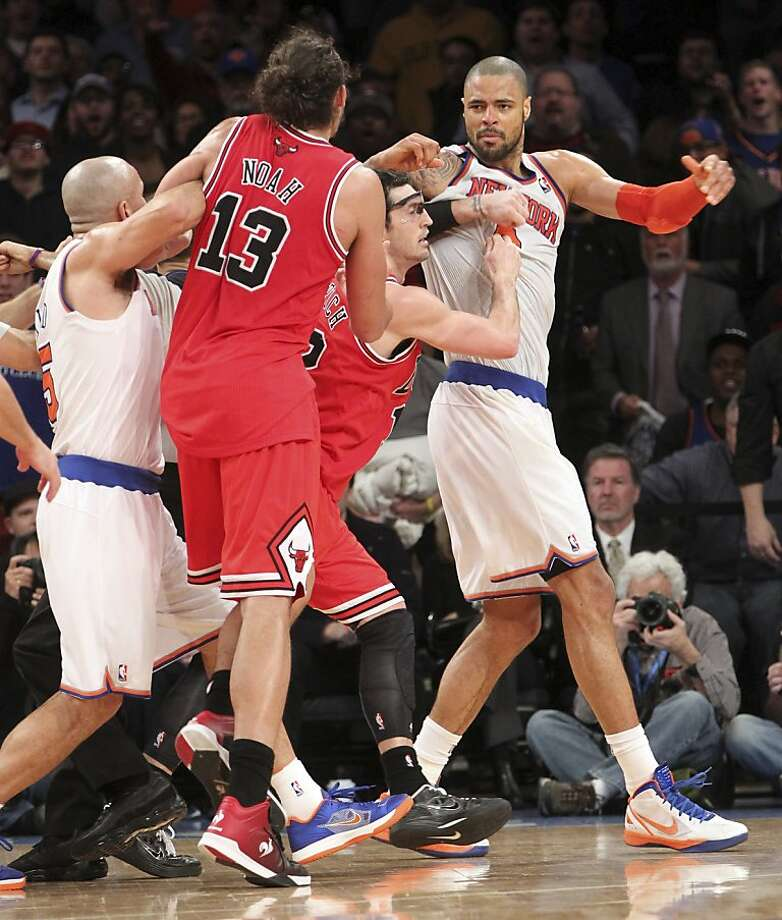 New York Knicks' Jason Kidd, left, and Chicago Bulls' Kirk Hinrich, second from right, separate Bulls' Joakim Noah (13) and Knicks' Tyson Chandler, right, during the second half of an NBA basketball game on Friday, Dec. 21, 2012, at Madison Square Garden in New York. The Bulls defeated the Knicks 110-96. (AP Photo/Mary Altaffer) Photo: Mary Altaffer, Associated Press
