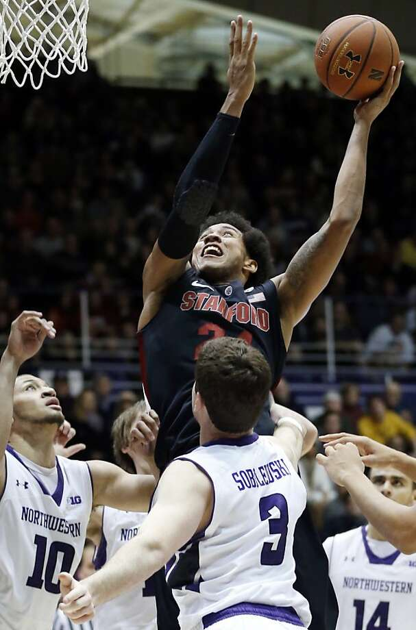 Josh Huestis tied his career high with 18 points and added 12 rebounds as Stanford held off Northwestern on the road despite blowing most of an 18-point lead during the first half. Photo: Nam Y. Huh, Associated Press