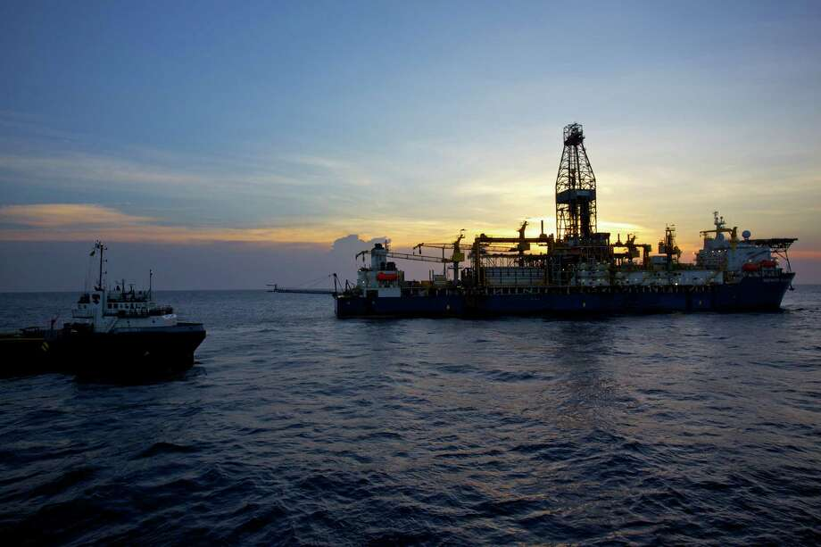The Deepwater Millennium drillship and a supply vessel work on an Anadarko Petroleum Corp. project in the Rovuma Basin off the coast of  Mozambique. Photo: Anadarko Petroleum Corp.