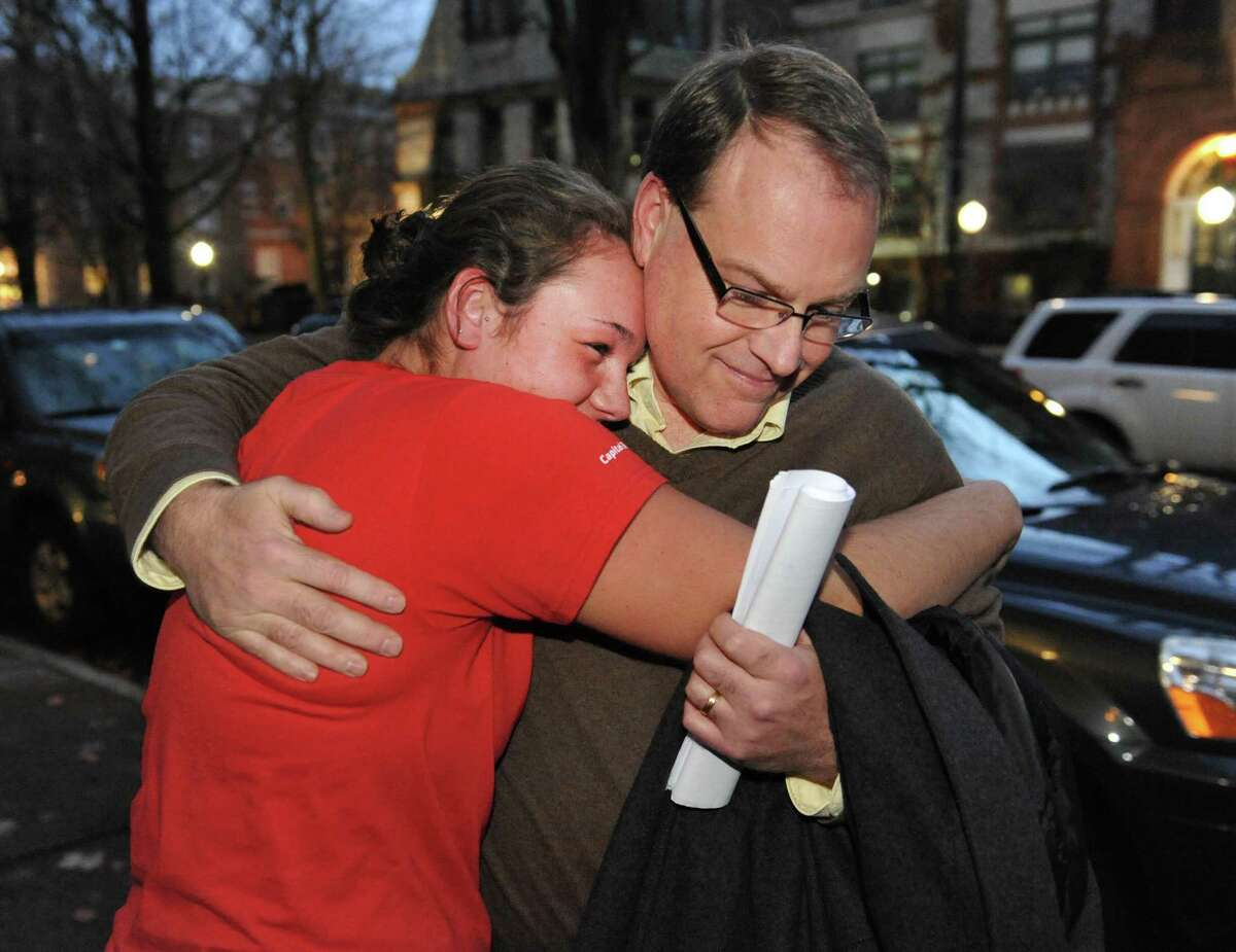Ed McDonough gets a hug from daughter Rachael McDonough, 18, outside Rensselaer County Court after being found not guilty in his ballot fraud case Friday Dec. 21, 2012. (John Carl D'Annibale / Times Union)