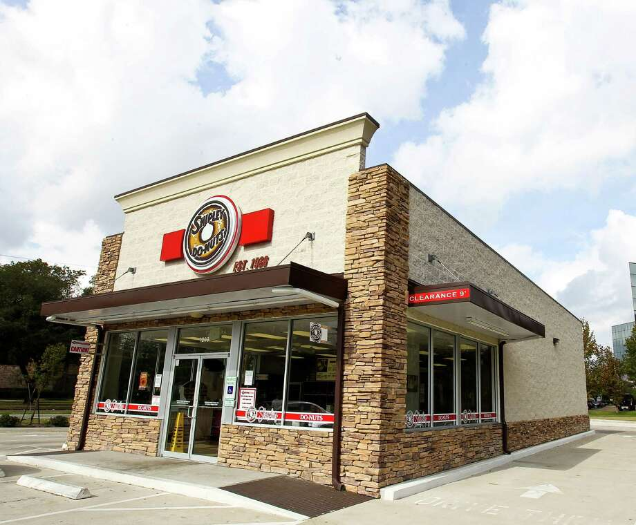 Shipley's Do-Nuts, founded in 1936, is modernizing its look, inside and out, and selling new products such as mugs and one-pound bags of Founders Blend coffee. The new Dairy Ashford shop, below, has a modern look. Photo: Nick De La Torre, Staff / © 2012  Houston Chronicle