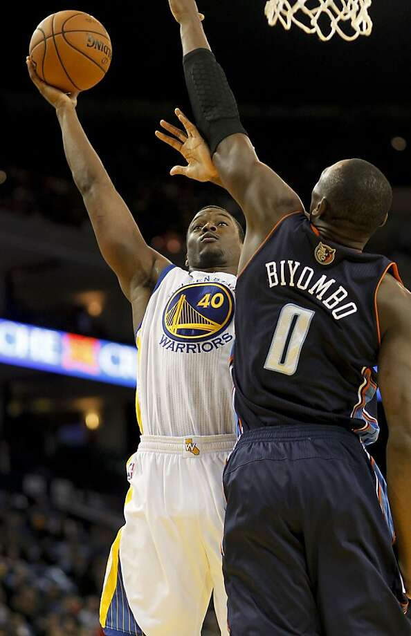 Warriors Harrison Barnes, (40) up against the Bobcats Bismack Biyombo, (0) in the first quarter,  as the Golden State Warriors take on the Charlotte Bobcats in NBA action in Oakland, Calif. on Friday Dec. 21,2012. Photo: Michael Macor, The Chronicle