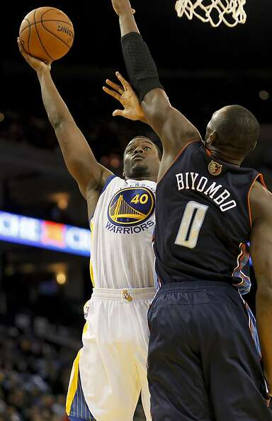 Warriors Harrison Barnes, (40) up against the Bobcats Bismack Biyombo, (0) in the first quarter,  as