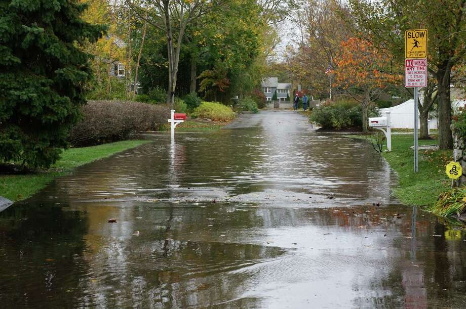 Flooding on Quentin Road in the Compo Beach neighborhood on Tuesday, Oct. 30, the day after Superstorm Sandy hit Westport. A new text amendment passed by the Planning and Zoning Commission aims to help shoreline homeowners more easily raise their homes to avoid flooding damage during future storms. Photo: Paul Schott / Westport News