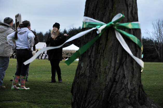 Sarah Ferris, 20, right, coordinates volunteers in preparation for a candle light vigil on the soccer fields of Fairfield Hills Campus in Newtown on Friday, Dec. 21, 2012, one week after the Sandy Hook Elementary School shooting. Photo: Jason Rearick / The News-Times
