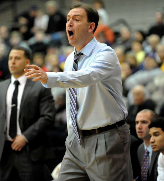 UAlbany's coach Will Brown instructs his team during their basketball game against Quinnipiac on Fri