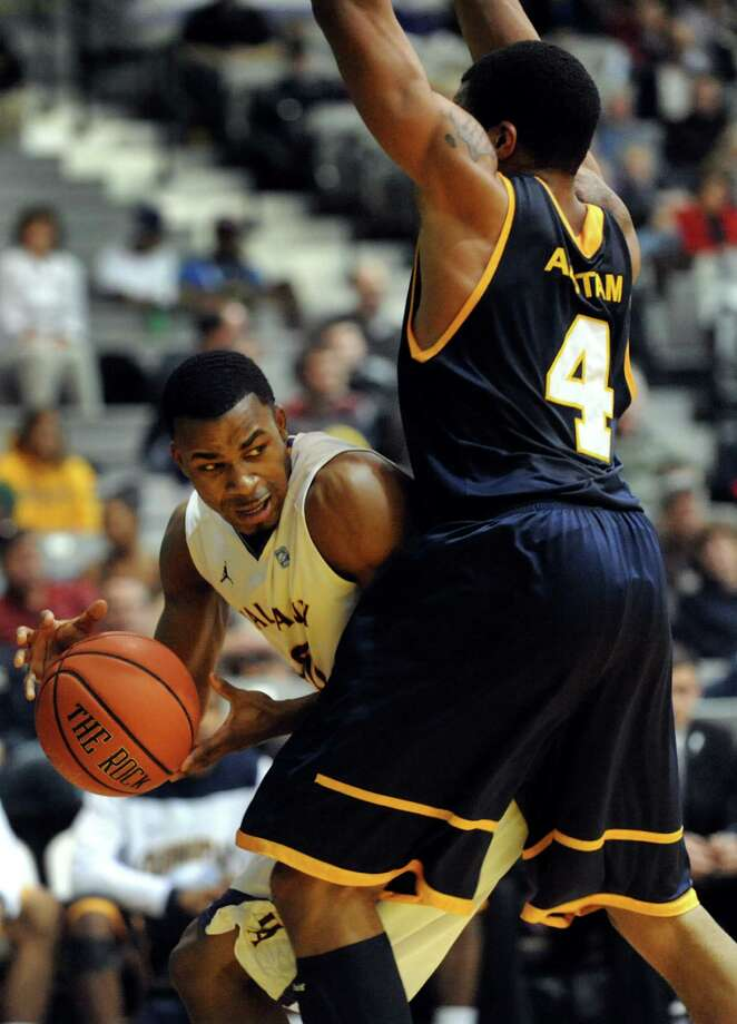 UAlbany's Mike Black(10) looks to pass as Quinnipiac's Ike Azotam (4) defends during their basketball game on Friday, Dec. 21, 2012, at UAlbany in Albany, N.Y. (Cindy Schultz / Times Union) Photo: Cindy Schultz / 00020487A