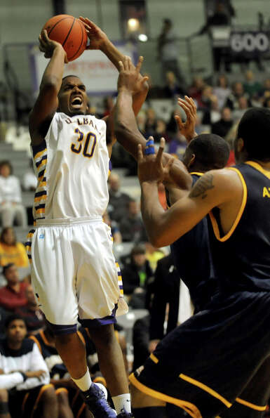 UAlbany's Jayson Guerrier (30) shoots for the hoop during their basketball game against Quinnipiac o
