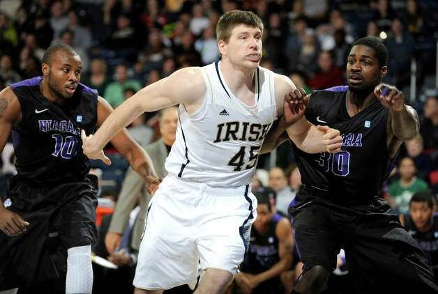 Notre Dame forward Jack Cooley, center, battles for rebounding position with Niagara guard Juan'ya Green, left, and forward Joe Thomas during the first half of an NCAA college basketball game on Friday, Dec. 21, 2012, in South Bend, Ind. (AP Photo/Joe Raymond) Photo: Joe Raymond